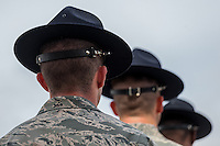 Semi-silhouette of three US Air Force instructors wearing hats.