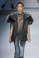 Shu Pei Qin walks runway in a charcoal melton oversized sleeveless jacket with raccoon collar Steel silk chiffon cowl neck halter top, and column print faille flared pant with charcoal melton zip-front peplum, from the Vera Wang Fall 2012 Vis-a-gris collection, during Mercedes-Benz Fashion Week Fall 2012 in New York.
