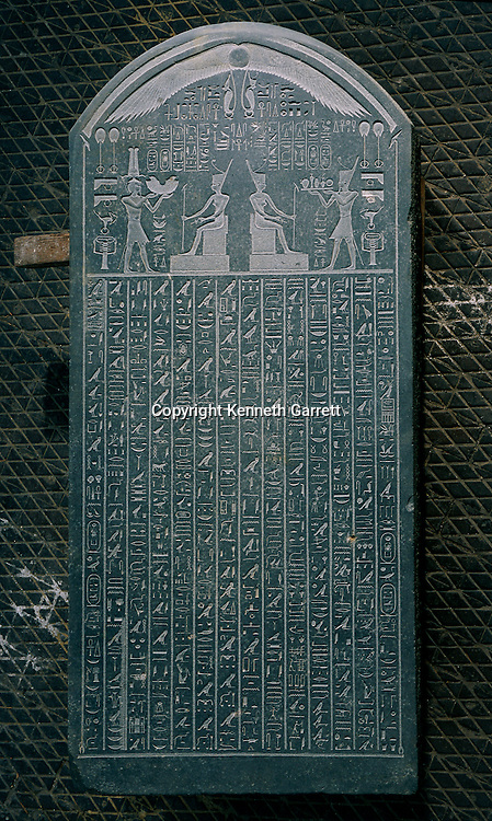 A stela with text recording a royal decree stating that a tenth of the taxes collected on imported goods should be donated to the temple of the goddess Neith in Sais, Nectanebo I, Late Period