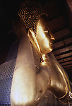 The great reclining Buddah relaxes in a temple in the Wat Po Temple Complex in in Bangkok, Thailand. (Jim Bryant Photo).....