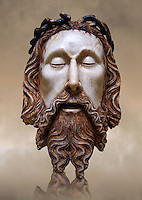 Gothic wood statue of the Head of Christ by  Jaume Cascalls. Carved alabaster with polychrome and gilt remains.  This head must have belonged to a Recumbent Christ which could have formed part of a sculptural group of the Holy Sepulchre. It probably came from the chapel of Corpus Christi of the convent of Sant Agust&iacute; Vell, Barcelona.<br /> Jaume Cascalls is one of the most important sculptors of the fourteenth century in Catalonia. This is borne out by his involvement over almost thirty years with the project of the royal pantheon in Poblet for King Peter the Ceremonious and with other large undertakings of the time. Today, on stylistic grounds, he is credited with this 'Head of Christ', which must have formed part of a sculptural group of the Holy Sepulchre, presumably from the church of the convent of Sant Agust&iacute; Vell in Barcelona. The break in the neck suggests it belonged to a full-length recumbent Christ, like the one kept at Sant Feliu in Girona and also attributed to Cascalls. National Museum of Catalan Art, inv no: 034879-000