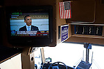 President Barack Obama speaks live on Republican presidential candidate Michele Bachmann's campaign bus as she speaks at a campaign stop in Atlantic, Iowa, August 8, 2011.