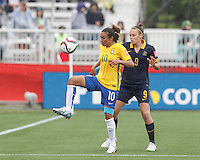 Moncton, New Brunswick - June 21, 2015:  In a FIFA Women's World Cup Canada 2015 Round of<br /> 16 match, Australia (blue) defeated Brazil (yellow/blue), 1-0, at Moncton Stadium.