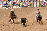 Team roping at the Jordan Valley Big Loop Rodeo, Ore..
