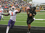 07 October 2006: Wake Forest quarterback Riley Skinner (11) beats Clemson's Duane Coleman (3) and catches a touchdown pass. The Clemson University Tigers defeated the Wake Forest University Demon Deacons 27-17 at Groves Stadium in Winston-Salem, North Carolina in an Atlantic Coast Conference NCAA Division I College Football game.