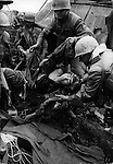 U.S. Marines carry a wounded North Vietnamese soldier, Têt offensive, Battle of Hué, Vietnam, February 1968
