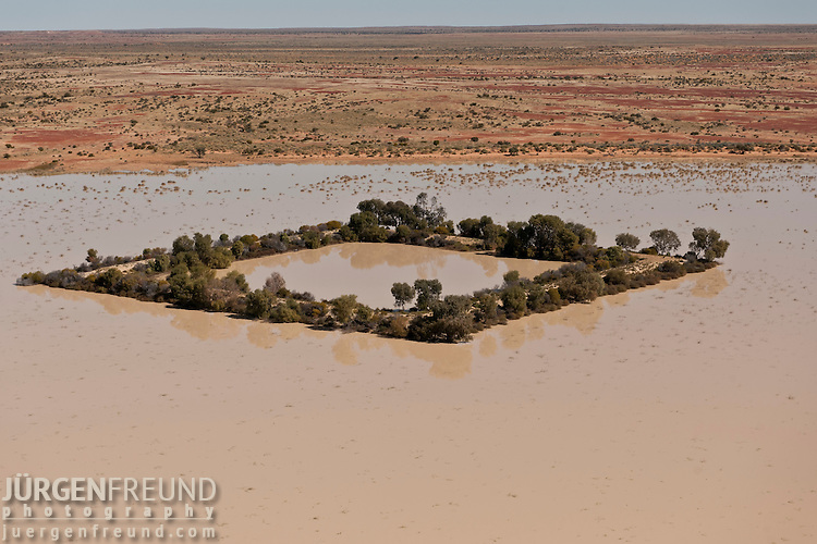Aerial - Dam in the outback serving as watering holes for cattle. Dam water comes from bore water from the Great Artesian Basin