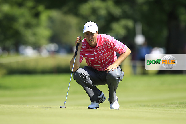Ross Fisher (ENG) lines up his putt on the 3rd green during Thursday's Round 1 of the 2013 BMW International Open held on the Eichenried Golf Club, Munich, Germany. 20th June 2013<br /> (Picture: Eoin Clarke www.golffile.ie)