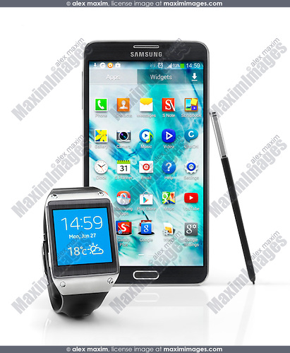 Samsung Galaxy Gear smartwatch and Galaxy Note III smartphone isolated on white background