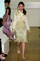 85 Broads member walks runway in a SS12 Olivia chantelle lace bow blouse, and SS12 Olivia chantelle lace skirt by Yuna Yang, during the 85 Broads Presents Yuna Yang trunk show at Art Gate Gallery on October 24th 2011.