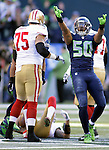 Seattle Seahawks  linebacker K.J. Wright (50) celebrates a sack  San Francisco 49ers quarterback Colin Kaepernick (7) at CenturyLink Field in Seattle, Washington on December 14, 2014.  Kapernick was sacked six times in the Seahawks 17-7 win  over the 49ers  © 2014. Jim Bryant Photo. All Rights Reserved.