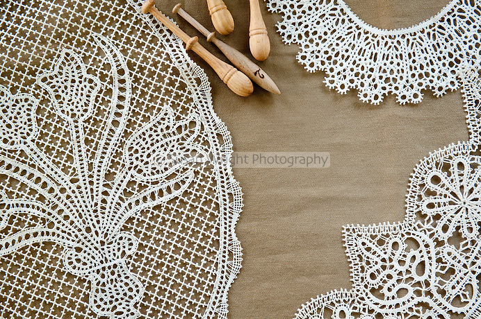Pillow lace or bobbin lace 'merletto a tombolo' hand made from 100% linen thread using wooden bobbins (fuselli or piombini), Anghiari, Tuscany, Italy