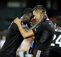 Washington D.C. - July 21, 2014: Luis Silva (11) of D.C. United celebrates his score with teammate Eddie Johnson.  D.C. United defeated the Chivas USA 3-1 during a Major League Soccer match for the 2014 season at RFK Stadium.