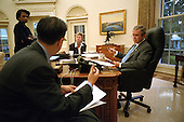 Washington, DC - September 20, 2001 -- United States President George W. Bush meets in the Oval Office with top advisors to prepare his address to a Joint Session of Congress on September 20, 2001.  With The President are: Condoleezza Rice, National Security Advisor;  Mike Gerson, Director of Presidential Speechwriting; and Karen Hughes, Counselor to the President..Mandatory Credit: Eric A. Draper - The White House via CNP