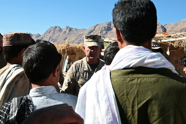 Brig. Gen. Larry Nicholson, commander of the 2nd Marine Expeditionary Brigade, chats with villagers in the Golestan district bazaar, in western Afghanistan's Farah province. Nov. 13, 2009. DREW BROWN/STARS AND STRIPES