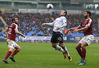 Bolton Wanderers' Adam Le Fondre controls the ball under pressure from Northampton Town's Lewin Nyatanga<br /> <br /> Photographer Alex Dodd/CameraSport<br /> <br /> The EFL Sky Bet League One - Bolton Wanderers v Northampton Town - Saturday 18th March 2017 - Macron Stadium - Bolton<br /> <br /> World Copyright &copy; 2017 CameraSport. All rights reserved. 43 Linden Ave. Countesthorpe. Leicester. England. LE8 5PG - Tel: +44 (0) 116 277 4147 - admin@camerasport.com - www.camerasport.com