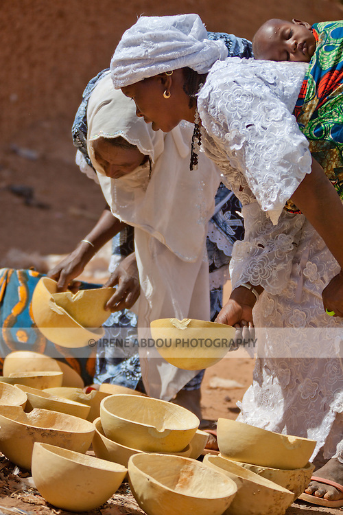 Two Fulani women inspect the calabashes for sale in the weekly market of Djibo in northern Burkina Faso.