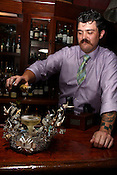June 2, 2010. Raleigh, North Carolina..Scott Ritchie serves champagne at Whiskey.