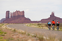 Cyclists Robert Armstrong, left, Katha Jenkins, writer Christopher Solomon, and guide Eric Proano climb toward Monument Valley Navajo Tribal Park, rear, on the Utah-Arizona border. The Red Rock Canyons Tour, organized by Lizard Head Cycling Tours, wound through 400 miles of the desert southwest. The route traveled through canyons and national monuments in Colorado, Utah and Arizona, ending at Lake Powell. (Kevin Moloney for the New York Times)