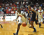"Ole Miss' Martavious Newby (1) vs. Auburn forward Allen Payne (2) at the C.M. ""Tad"" Smith Coliseum on Saturday, February 23, 2013. Mississippi won 88-55. (AP Photo/Oxford Eagle, Bruce Newman)"