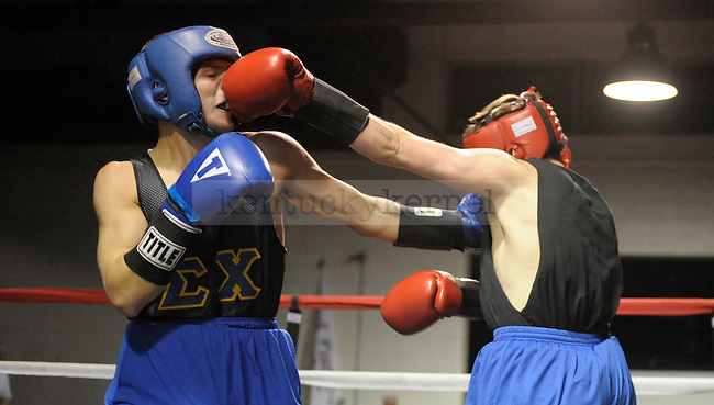 Scott Hiles (left) of Sigma Chi fights Hayden McNeil (right) of Beta Theta Pi at the Sigma Chi Fraternity & Alpha Delta Pi Sorority sponsored The Main Event 2011 in Lexington, Ky. Scott Hiles won by decision. Photo by Mike Weaver |