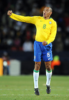 Gilberto Silva of Brazil celebrates the winning goal. Brazil defeated South Africa 1-0 during the semi-finals of the FIFA Confederations Cup at Ellis Park Stadium in Johannesburg, South Africa on June 25, 2009..