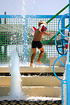 Stock photo of a Little boyl in inflatable swimming arm bands playing in Fasoury Watermania water park Cyprus Summer 2007 Vertical Summer vacation leisure activities healthy lifestyle recreational concept