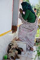 A woman prays at the Nanda Devi temple near Munsyari, during the Nanda Devi Mela. Yes, those are sacrificial sheep heads at her feet.