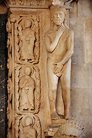 Romaesque doorway with sculptures of Adam by the Croatian architect Master Radovan. Saint Lawrence Cathedral - Trogir - Croatia