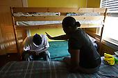 African - american family at the shelter for homeless in Woodbridge. Many people evicted from their homes have to stay here temporary until they find their own place to sleep.This area has been badly hit by crisis in property market. Lots of houses are foreclosed or abandoned. Value of many properties here has dropped by half within one year.  Woodbridge, Northern Virginia, USA .June 2008<br /> <br /> (Photo by Piotr Malecki / Napo Images)  <br /> Matka i syn w schronisku dla bezdomnych.W zwiazku z kryzysem nieruchomosci schroniska sa pelne ludzi, ktorzy utracili swoje domy.Polnocna Wirginia, a szczegolnie Prince William County jest jednym z najmocniej dotknietych kryzysem nieruchomosci miejscem w Stanach Zjednoczonych. Setki tysiecy domow sa opuszczane przez wlascicieli bez widokow ani na ich sprzedaz ani na splate zaciagnietego kredytu.Woodbridge, Wirginia, USA Czerwiec 2008.(Photo by Piotr Malecki / Napo Images)