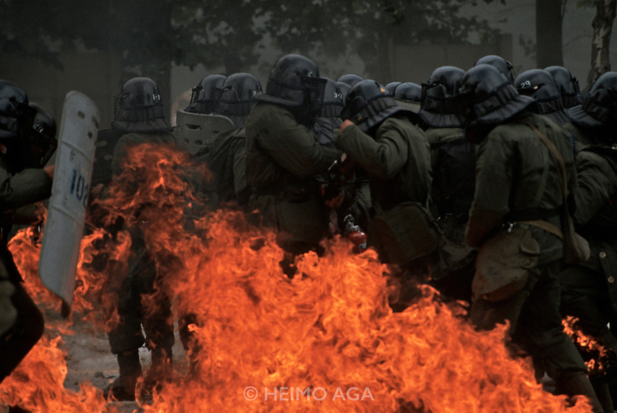 Seoul, Korea. Riot police engulfed in flames.
