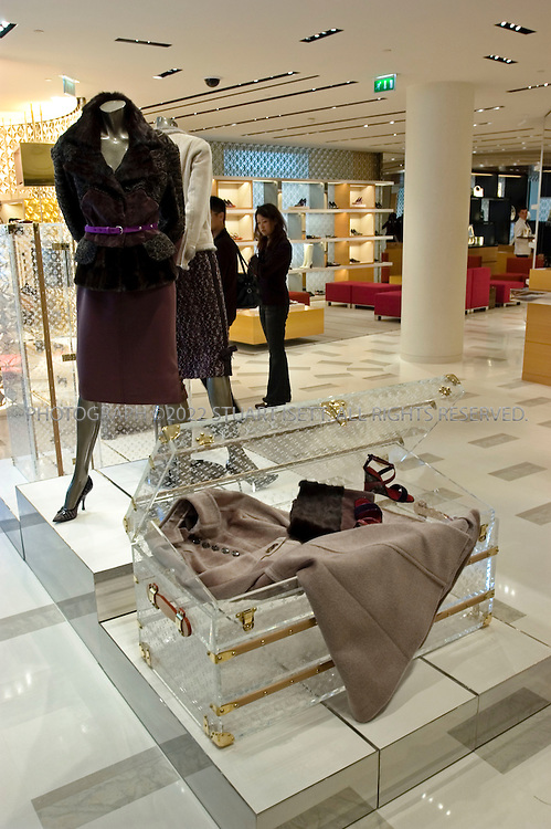 """10/9/2005--Paris, France.the 2nd floor womens' section of French luxury goods maker Louis Vuitton who opened its biggest store yet on the Champs Elysees in Paris, after a 20-month redesign and enlargement project. The flagship store at 101, avenue des Champs Elysees has been redecorated and enlarged at an undisclosed cost. ..About 300 VIPs, including Hollywood stars Sharon Stone and Uma Thurman and French actress Catherine Deneuve, attended the official opening before American designer Marc Jacobs unveils his ready-to-wear spring-summer 2006 collection for Louis Vuitton. Behind the face-lift are US architects Eric Carlson and Peter Marino who sought to create a feeling of the famous promenade along the Champs Elysees continuing into the store...Throughout, it has features alluding to aspects of the fabled Champs Elysees such as brown and beige limestone flooring which echoes the paving stones on the street outside. Features include a light sculpture by American James Turrell, a 20-metre (65 feet) long """"travelling staircase"""" showcasing the work of American video artist Tim White-Sobieski and an elevator linking the store to the top floor by Denmark's Olafur Eliasson..Photograph By Stuart Isett.All photographs ©2005 Stuart Isett.All rights reserved."""