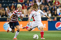 Pang Fengyue (17) of China PR (CHN) is marked by Megan Rapinoe (15) of the United States (USA). The United States (USA) women defeated China PR (CHN) 4-1 during an international friendly at PPL Park in Chester, PA, on May 27, 2012.