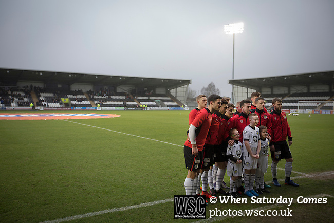 St Mirren 4 The New Saints 1, 19/02/2017. Paisley 2021 Stadium, Scottish Challenge Cup. The home team pose for a photograph with mascots at the Paisley2021 Stadium before Scottish Championship side St Mirren played Welsh champions The New Saints in the semi-final of the Scottish Challenge Cup for the right to meet Dundee United in the final. The competition was expanded for the 2016-17 season to include four clubs from Wales and Northern Ireland as well as Scottish Premier under-20 teams. Despite trailing at half-time, St Mirren won the match 4-1 watched by a crowd of 2044, including 75 away fans. Photo by Colin McPherson.