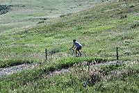 Man riding on a rural bike trail, Boulder, Colorado, USA