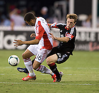 Jared Jeffrey (25) of D.C. United collides with Darel Russell (16) of Toronto FC during a game at RFK Stadium in Washington, DC.  D.C. United tied Toronto FC, 1-1.