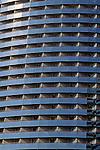 Hotel balconies along waterfront with one man on balcony San Diego California USA