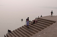 Indian men bathes at a ghat in Varanasi, Uttar Pradesh, India.