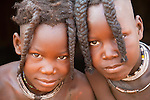 The Himba are a semi-nomadic, pastoral people living in the arid regions of northern Namibia. These two girls have wonderful braids which are covered in butter fat and red ochre.