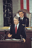 United States President Jimmy Carter presents his National Energy Plan to a joint session of the US Congress in the US Capitol in Washington, DC on April 20, 1977.  Seated behind the President is US Vice President Walter Mondale.<br /> Credit: Arnie Sachs / CNP