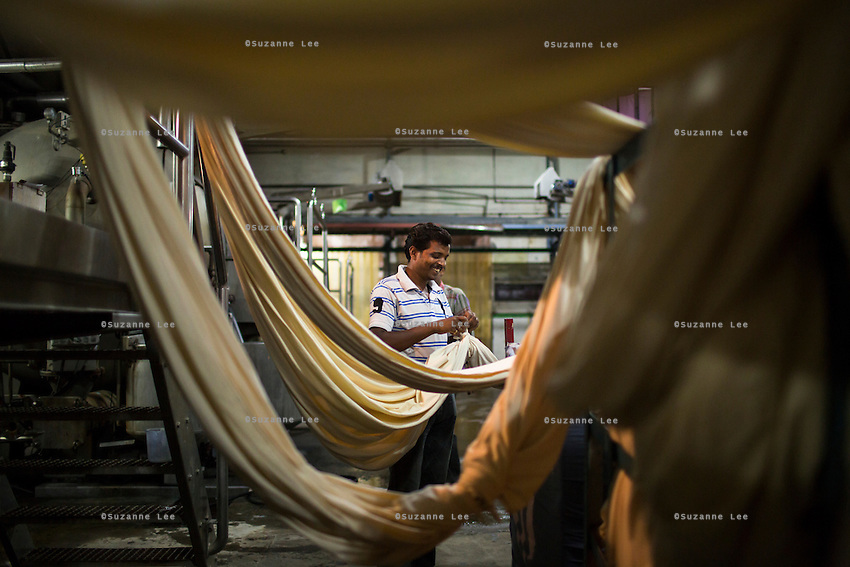 Workers work on dying textiles in the Dye House at the Pratibha vertically integrated garment unit in Indore, Madhya Pradesh, India on 11 November 2014. Photo by Suzanne Lee for Fairtrade