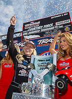 Sep 4, 2016; Clermont, IN, USA; NHRA funny car driver Courtney Force celebrates after winning the Traxxas Shootout speciality race during qualifying for the US Nationals at Lucas Oil Raceway. Mandatory Credit: Mark J. Rebilas-USA TODAY Sports