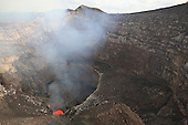 Lava lake in bottom of Santiago Crater of erupting Masaya Volcano, Nicaragua