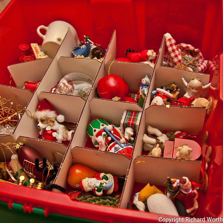 Ornaments in their storage box wait to be placed on this year's Christmas tree.