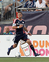 New England Revolution defender Chris Tierney (8) looks to pass. In a Major League Soccer (MLS) match, the New England Revolution tied the Seattle Sounders FC, 2-2, at Gillette Stadium on June 30, 2012.