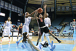 16 December 2014: Oregon State's Gabriella Hanson (11) is fouled by North Carolina's Latifah Coleman (2) as Stephanie Mavunga (1) and Megan Buckland (below) watch. The University of North Carolina Tar Heels hosted the Oregon State University Beavers at Carmichael Arena in Chapel Hill, North Carolina in a 2014-15 NCAA Division I Women's Basketball game. Oregon State won the game 70-55.