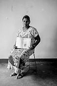 38 year old  Srikaran Rajeshwary poses for  photo with her CHDR- Child Health Development Record Card (immunization/vaccination card) in Punaineeravi Village in Kilonochchi, Sri Lanka.  Photo: Sanjit Das/Panos