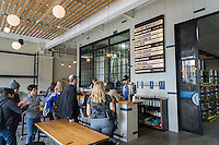 The taproom of the Kings County Brewers Collective in the Bushwick neighborhood of Brooklyn in New York on Sunday, October 16, 2016. The newly opened brewery and taproom is the first brewery to open in Bushwick since 1976 (© Richard B. Levine)