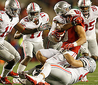 Wisconsin Badgers fullback Austin Ramesh (20)is tackled by Ohio State Buckeyes defensive end Nick Bosa (97) in the second half of their game at Randall Stadium in Madison, Wisconsin on October 15, 2016. (Columbus Dispatch photo by Brooke LaValley)