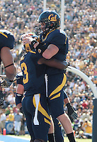 Jeremy Ross celebrates with Beau Sweeney. The University of California Berkeley Golden Bears defeated the UC Davis Aggies 52-3 in their home opener at Memorial Stadium in Berkeley, California on September 4th, 2010.
